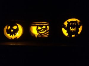 Halloween Pet Safety tips with frightening pumpkin carvings