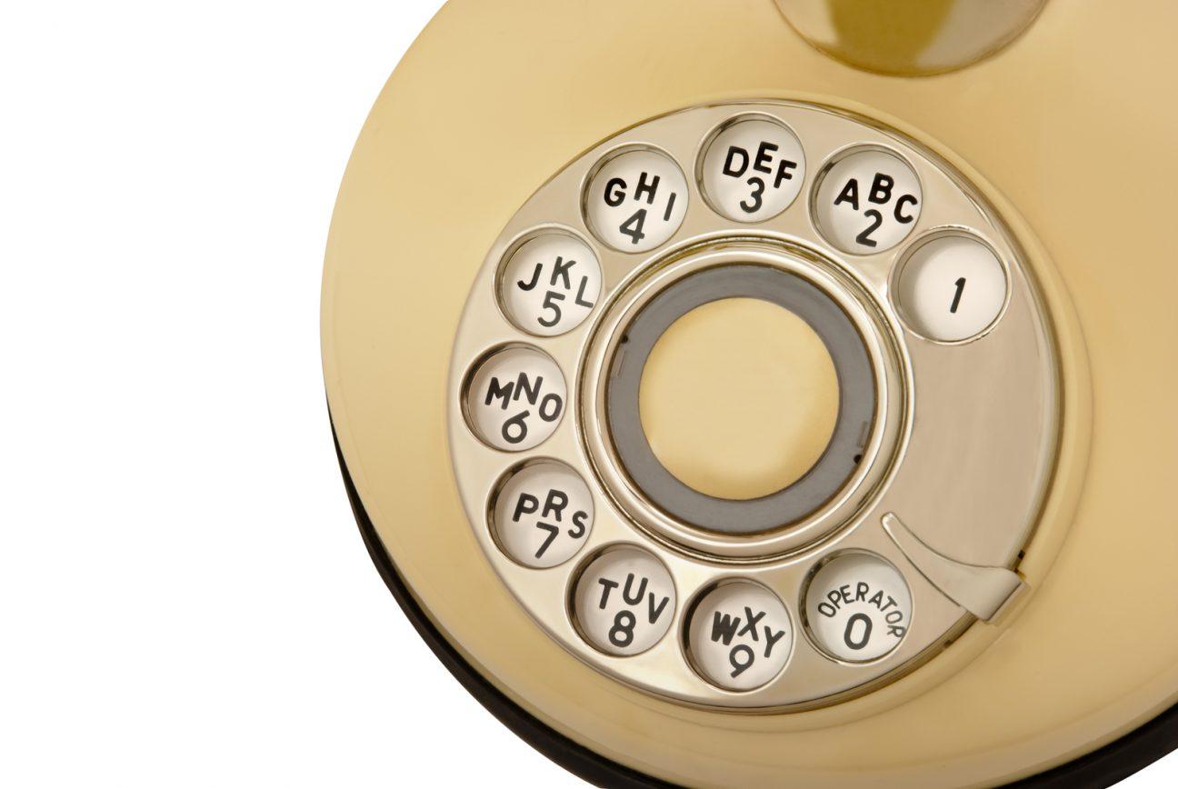 rotary phone dial macro image with yellow phone