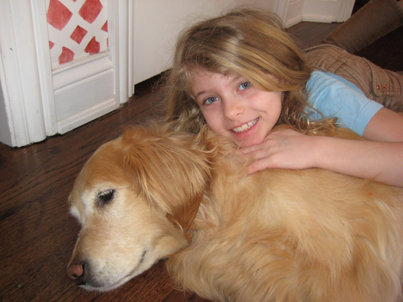 Scott Milligan, founder of PetCure Oncology photo of daughter and dog juliette